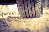 picture of track field  - Closeup car tire on the ground - JPG