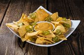 stock photo of nachos  - Nachos with Cheese Sauce  - JPG