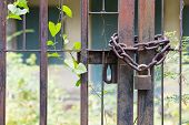 picture of lasso  - Padlock lasso with rusty chain in the old house - JPG