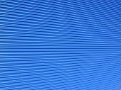 stock photo of roller door  - blue painted galvanised steel warehouse roller shutter background with an abstract diminishing perspective - JPG