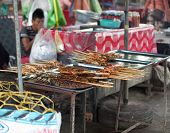 stock photo of stall  - Traditional asian market stall full of grilled fish - JPG