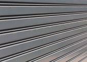 image of roller shutter door  - steel roller shutter door weathered - JPG