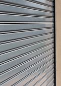 stock photo of roller shutter door  - steel roller shutter door weathered - JPG
