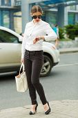 picture of shiting  - Stylish business woman in the big city - JPG