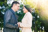picture of flirt  - Smiling couple dating and flirting in park - JPG