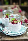 picture of pomegranate  - Pomegranate and kiwi chia seeds pudding in a jar for breakfast - JPG