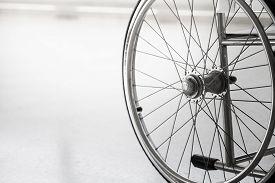 image of wheelchair  - Empty wheelchair parked in hospital hallway - JPG