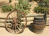 pic of peyote  - historical barrel and old weel near the fence sunny day - JPG