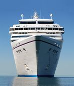 image of cruise ship  - water level view of cruise ship facing the bow - JPG