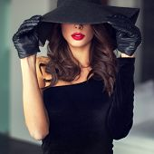 Sexy Brunette Woman With Red Lips In Hat poster