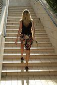 Blonde Girl Walking On Stairs
