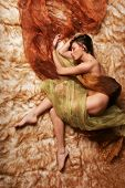 Beautiful woman sleeping covered in silk