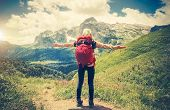 Traveler Woman with backpack hands raised mountaineering poster