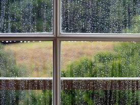 stock photo of rainy weather  - looking out of the window on a wet and rainy day - JPG