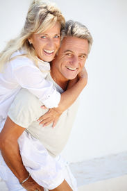 foto of beautiful senior woman  - Happy mature couple having fun over white background - JPG