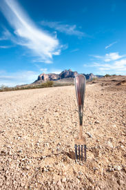 stock photo of dirt road  - A fork in the road infers a decision point in ones life - JPG
