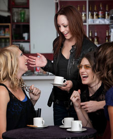 foto of foursome  - Foursome of young cute teen friends laughing at a cafe - JPG