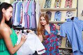 Girl seller helps shoppers