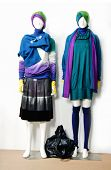 female clothing in skirt with hat and bag ,scarf, on two mannequin