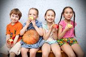 group of preschool children to eat apples