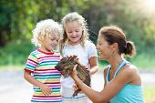 Kids With Baby Pig Animal. Children At Farm Or Zoo poster