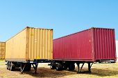 red and yellow container on truck trailer
