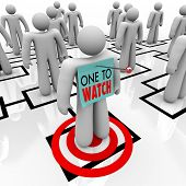 An employee is marked with a note reading One to Watch representing that he or she has been either i