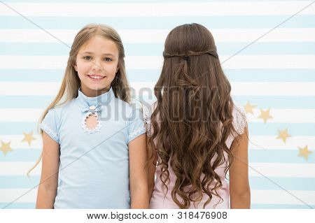 poster of Best Hairstyles For Long Hair. Cute Small Girls With Long Brunette And Blond Curls In Playroom. Ador