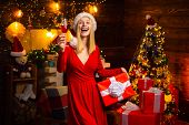 Pleasant Moments. Christmas Joy. Woman Decorated Interior Garland Lights Drink Champagne. Christmas  poster