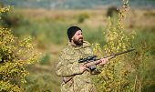 Hunting Masculine Hobby. Man Brutal Gamekeeper Nature Background. Hunter Hold Rifle. Bearded Hunter  poster