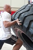 TOA PAYOH, SINGAPORE - MARCH 24 : Contender for Strongman Sulaiman Ismail attempting the six times 3