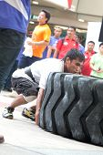 TOA PAYOH, SINGAPORE - MARCH 24 : Contender for Strongman Mohd Asri Abd Kadir attempts the 350kg tim