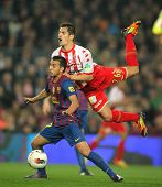 BARCELONA - MARCH 3: Pedro Rodriguez(L) of Barcelona vies with Pedro Orfila(R) of Sporting de Gijon