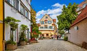 Cosy street in picturesque bavarian town Lindau at Lake Constance (Bodensee) in Germany. Traditional poster