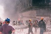 NEW YORK - SEPTEMBER 11: Emergency workers and journalists stand near the area known as Ground Zero