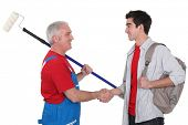 picture of school-leaver  - Experienced tradesman welcoming his new recruit - JPG