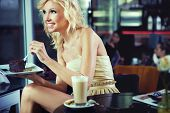 Cheerful blond beauty in a coffee shop