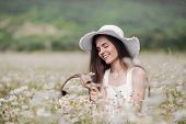 Beautiful Girl Outdoors With A Bouquet Of Flowers In A Field Of White Daisies,enjoying Nature. Beaut poster
