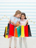Shopping, The Place For Fun. Cute Little Shoppers. Adorable Girls Looking Into Shopping Bags. Small  poster