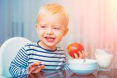 Kid Boy And Healthy Food. Boy Cute Baby Eating Breakfast. Baby Nutrition. Eat Healthy. Toddler Havin poster