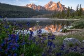 Beautiful Sunrise At Stanley Lake In The Sawtooth Mountains Of Idaho. Reflection In Water With Wildf poster