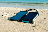 Alternative Energy Source. Battery Is Charged By Solar Energy. Charging Mobile Devices In The Wild.  poster