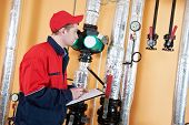 maintenance repairman engineer inspector of heating system equipment in a boiler house