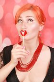 Surprised Sexy Girl Eating Lollipop. Beauty Glamour Model Woman With Heart Shape Red Sweet. poster