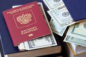 Passport Of Russian Citizen And Dollars In The Passport Against The Background Of Book Stacked Piles poster