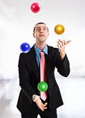 stock photo of juggler  - Portrait of a juggler playing with balls - JPG