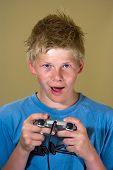 Boy Playing A Video Game poster