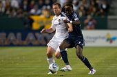 CARSON, CA - MAY 14: Los Angeles Galaxy F player Chad Barrett #11 (L) & Sporting Kansas City F playe