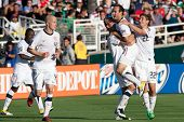 PASADENA, CA. - MAY 25: United States M Landon Donovan #10 celebrates with teammates after scoring during the 2011 CONCACAF Gold Cup championship game on May 25, 2011 at a sold out Rose Bowl in Pasadena, CA