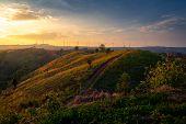 Wind Turbines And Orange Sunset Sky. Beautiful Mountain Landscape With Wind Generators Turbines,thai poster